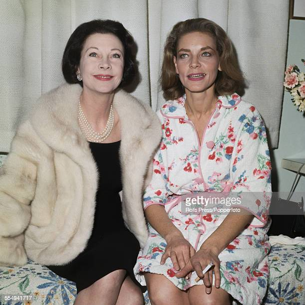 English actress Vivien Leigh pictured left with American actress Lauren Bacall backstage following Bacall's performance in the play 'Cactus Flower'...