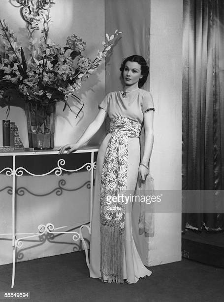 English actress Vivien Leigh wearing a fulllength evening gown and patterned sash 1937