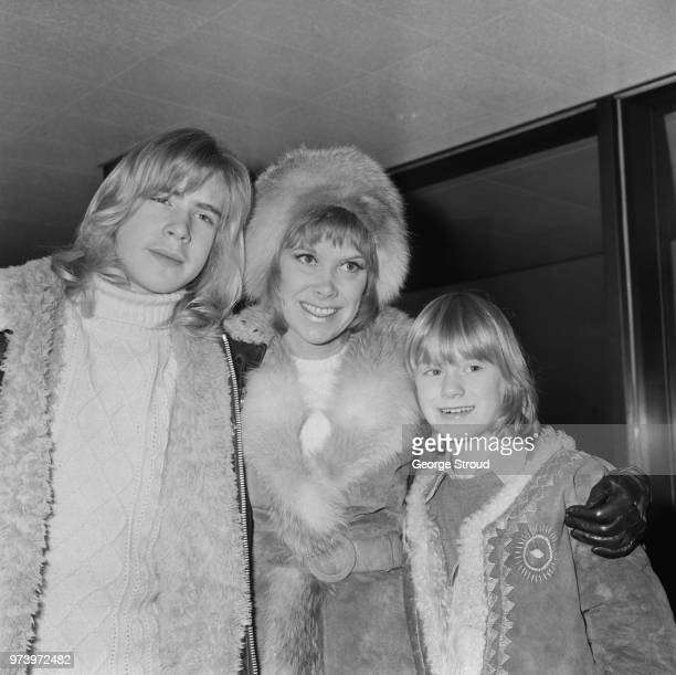 English actress Wendy Craig pictured with her sons Alaster and Ross at Heathrow airport in London as they await a flight to Switzerland on 3rd...