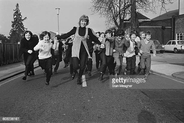 English actress Wendy Craig with some of the boys who are auditioning to costar with her in the new television series 'And Mother Makes Three' UK...