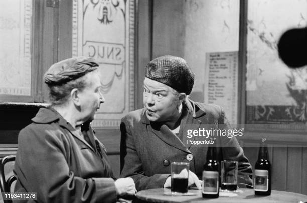 English actresses Margot Bryant as 'Minnie Caldwell' and on right Violet Carson playing 'Ena Sharples' pictured together in a scene set in the bar of...