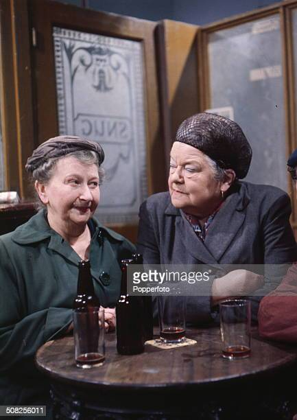English actresses Margot Bryant as 'Minnie Caldwell' and on right Violet Carson playing 'Ena Sharples' pictured in a scene set in the bar of The...