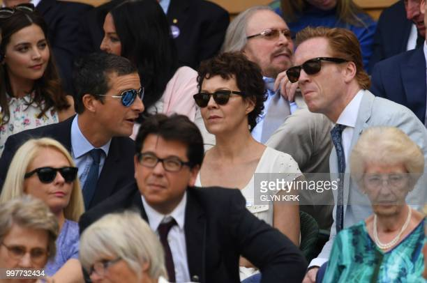 English adventurer Bear Grylls talks with actor Damian Lewis and Helen McCrory in the Royal box on Centre Court to watch US player John Isner play...