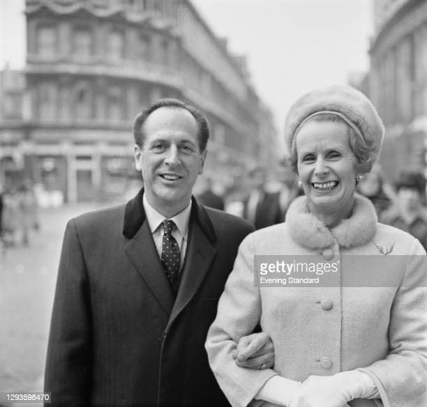 English airline executive Sir Giles Guthrie , chairman of BOAC, with his wife Rhona, Lady Guthrie, during a court case, UK, 12th January 1967.