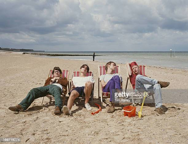 English alternative rock band Blur relax on a beach circa 1995 From left to right Graham Coxon Alex James Damon Albarn and Dave Rowntree