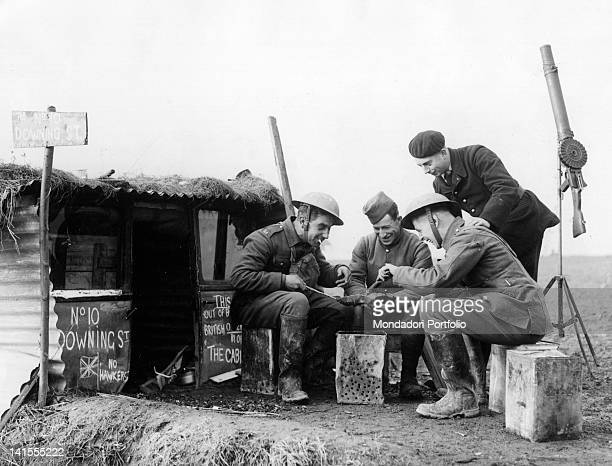 English and French soldiers cooking in front of a hut on the French northern front. Lorraine, October 1939