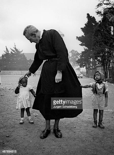English Anglican priest Trevor Huddleston with two small children in Johannesburg South Africa 1950s He was a vehement critic of apartheid and...