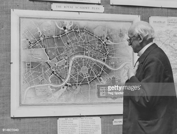 English architect Sir Edwin Lutyens examines the Royal Academy plans for a new Central London at an exhibition at Burlington House Piccadilly 13th...