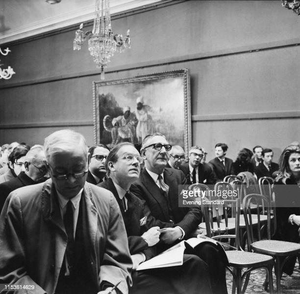 English art dealer and chairman of Thomas Agnew & Sons Geoffrey Agnew and British art expert and art dealer Evelyn Joll at an auction held at...