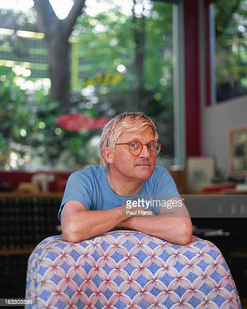 English artist David Hockney poses for a portrait in the living room of his Hollywood Hills home in April 1991 in Los Angeles California