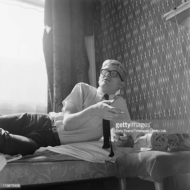 English artist David Hockney reclining on a bed 1963