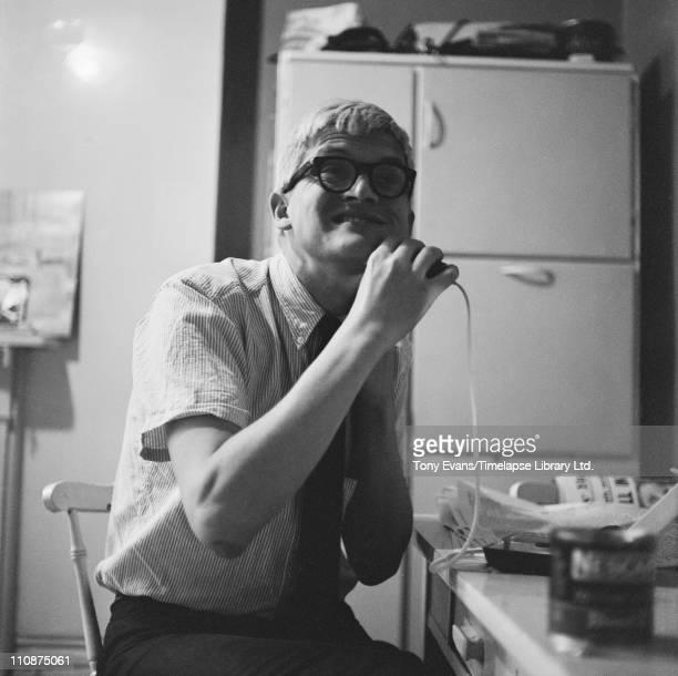 English artist David Hockney shaving 1963