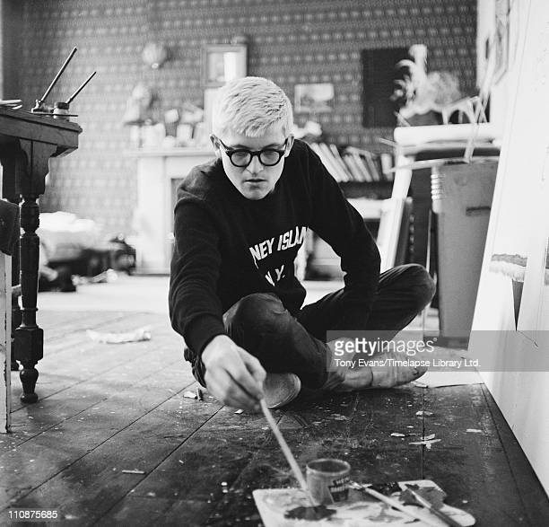English artist David Hockney working in a studio circa 1967