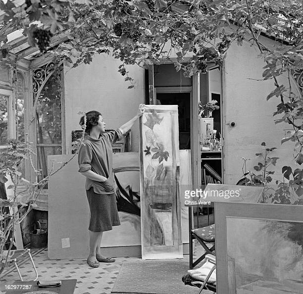 English artist Thelma Hulbert with some of her work at her home in Holland Park London October 1962 A parttime teacher at the Central School of Arts...