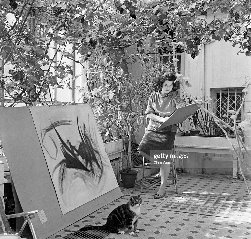 English artist Thelma Hulbert (1913 - 1995) working at her home in Holland Park, London, October 1962. A part-time teacher at the Central School of Arts & Crafts, she is about to mount an exhibition of her work at the Whitechapel Gallery.