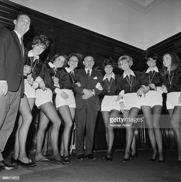 English association football referee George McCabe with hostesses at a reception organised by the London Society of Association Referees at Camden...
