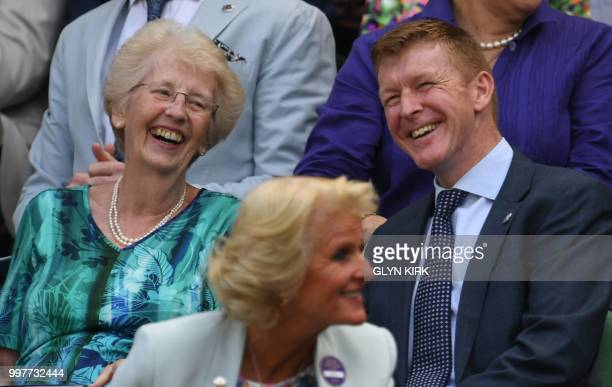 English astronaut Tim Peake sits in the Royal box on Centre Court to watch US player John Isner play South Africa's Kevin Anderson during their men's...