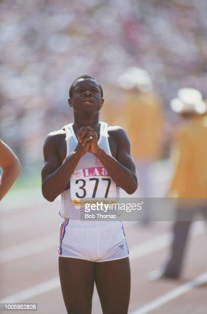 English athlete Ade Mafe of the Great Britain team looks up at the scoreboard to check the results after competing in one of the qualifying heats...
