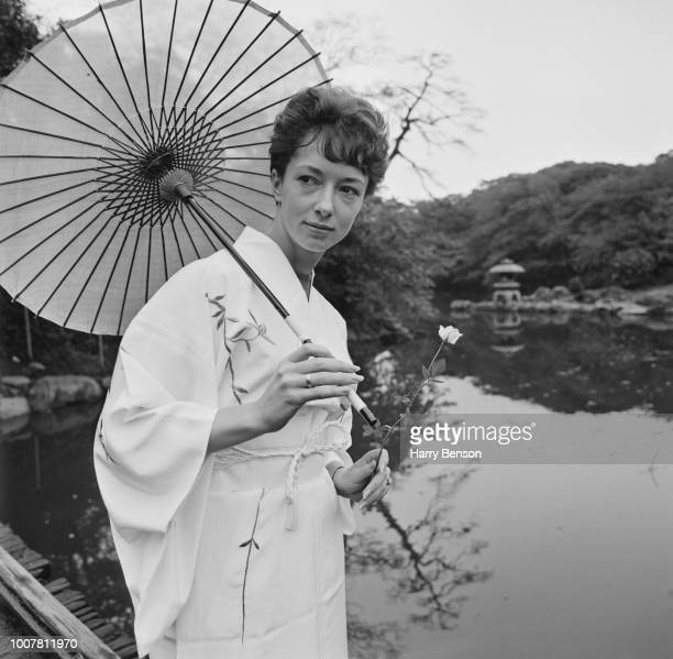 English athlete Ann Packer pictured dressed in a traditional Japanese kimono and holding a parasol as she prepares to compete for the Great Britain...