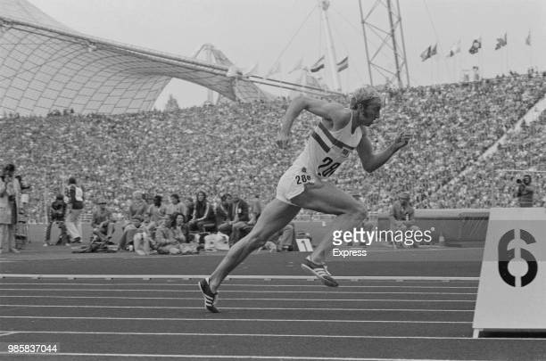 English athlete David Hemery competes for the Great Britain team to finish in third place to win the bronze medal in the Men's 400 metres hurdles...