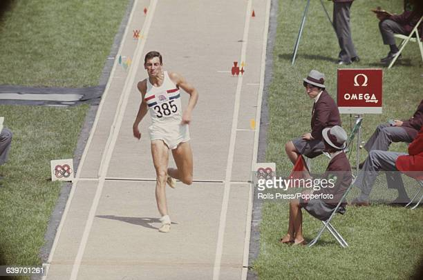 English athlete Fred Alsop of the Great Britain team, competes in the Men's triple jump event inside the Estadio Olimpico at the 1968 Summer Olympics...