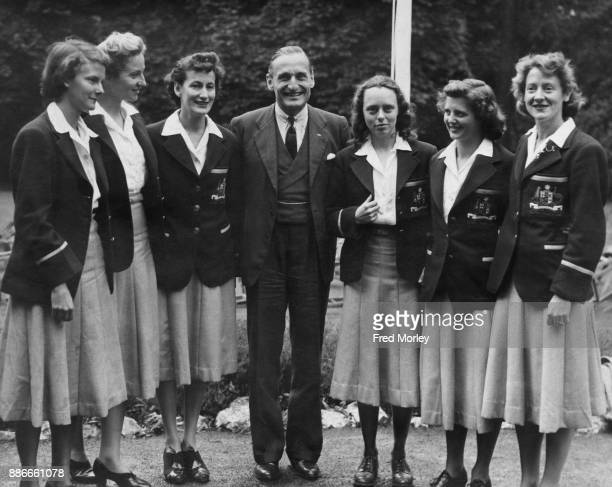 English athlete Lord Burghley later the 6th Marquess of Exeter a member of the Olympic committee with members of the New Zealand team at the opening...