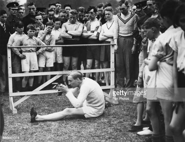 English athlete Lord Burghley later the 6th Marquess of Exeter gives a lecture on hurdling in Battersea Park London under the auspices of the AAA...