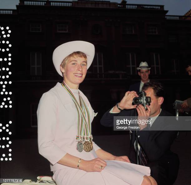 English athlete Mary Rand at Buckingham Palace in London after winning gold, silver and bronze medals at the Tokyo Olympics earlier that year, 27th...