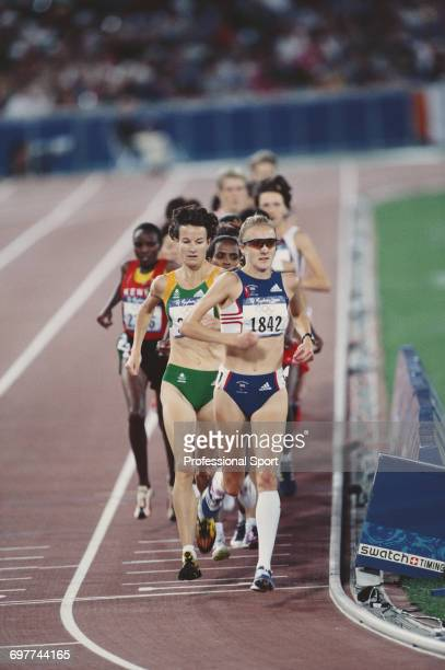 English athlete Paula Radcliffe leads Sonia O'Sullivan of Ireland and the rest of the pack to cross the finish line in fourth place for Great Britain...