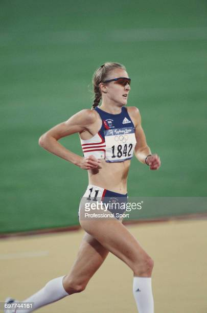 English athlete Paula Radcliffe pictured in action during competition to cross the finish line in fourth place for Great Britain in the final of the...