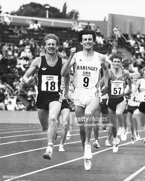 English Athlete Peter Elliott prepares to overtake fellow British runner and Olympic champion Sebastian Coe during the 1500m race at the Amateur...