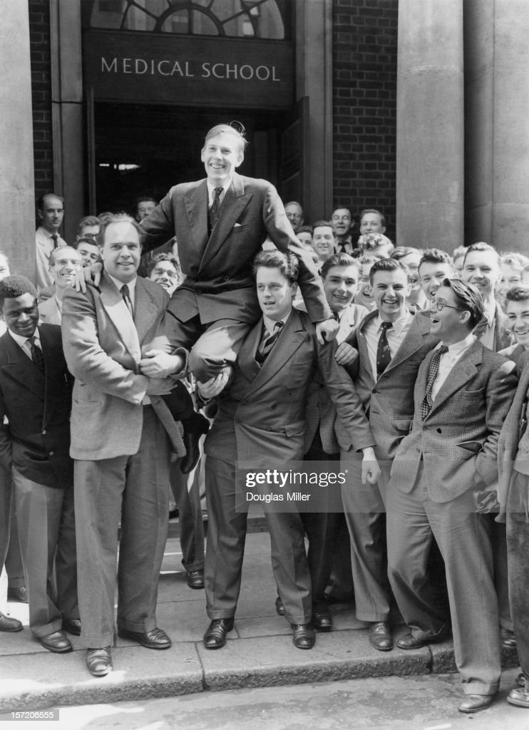 English athlete Roger Bannister is chaired by his fellow medical students at St Mary's Hospital, Paddington, the day after he ran his record-breaking sub-four minute mile, London, 7th May 1954.