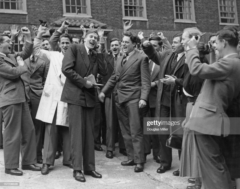 English athlete Roger Bannister is cheered by his fellow medical students at St Mary's Hospital, Paddington, the day after he ran his record-breaking sub-four minute mile, London, 7th May 1954.
