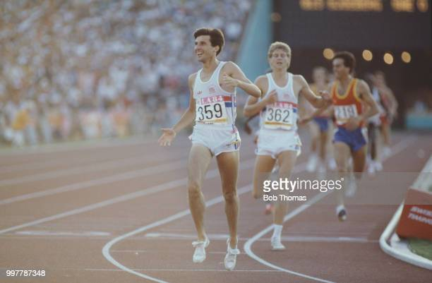 English athlete Sebastian Coe crosses the finish line in first place ahead of fellow Great Britain teammate Steve Cram to win the gold medal in the...