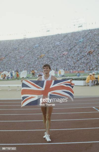 English athlete Sebastian Coe holds up a union flag after finishing in first place to win the gold medal in the final of the Men's 1500 metres event...