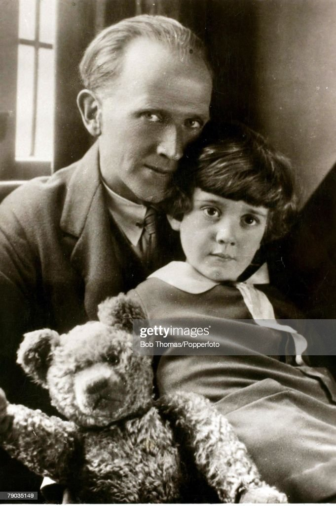 Literature. Circa 1930. English author A.A. Milne, (1882-1956). is pictured with his son Christopher Robin and Winnie the Pooh. : News Photo