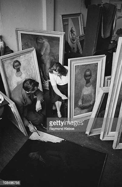 English author and visual artist Mervyn Peake at work in his studio with his wife the painter Maeve Gillmore December 1946 Original publication...