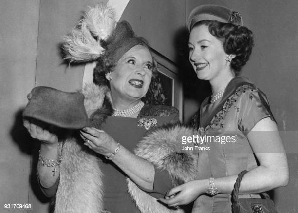 English author Barbara Cartland and her daughter Raine Legge discuss fashions before their appearance on the ITV programme 'How to Look Lovelier in...