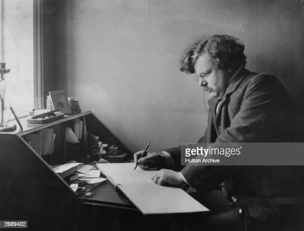 English author Gilbert Keith Chesterton at work
