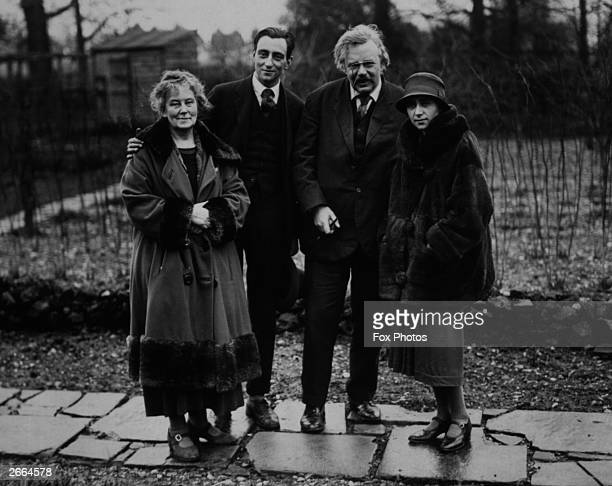 English author Gilbert Keith Chesterton in the garden of his home in Beaconsfield with his wife and children