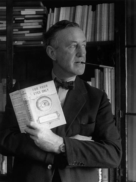 English author Ian Fleming in his study with a copy...