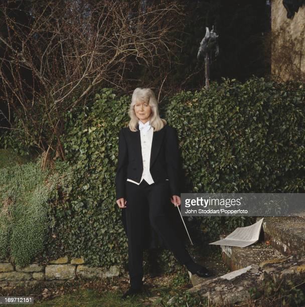 English author Jilly Cooper dressed as an orchestral conductor 1993