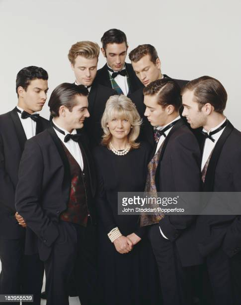 English author Jilly Cooper surrounded by attentive young men 1993