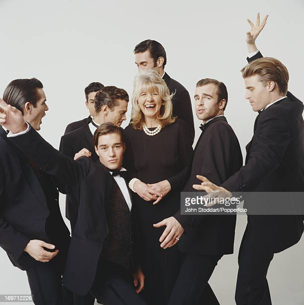 English author Jilly Cooper surrounded by eager young men 1993