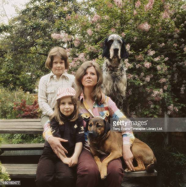 English author Jilly Cooper with her adopted children Felix and Emily and their dogs circa 1978