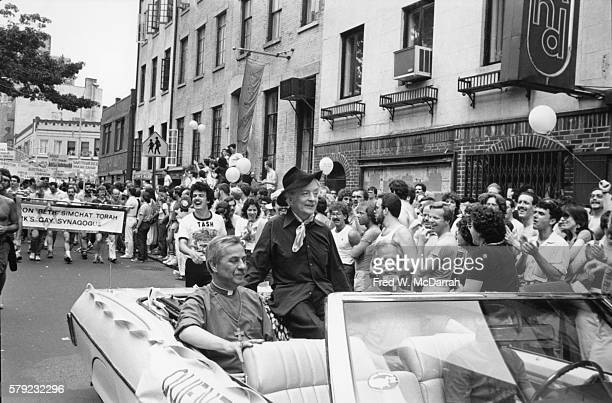 English author Quentin Crisp with the Church of the Beloved Disciple's Father John Darcy Noble and Bishop Robert Clement in the lead car of the...