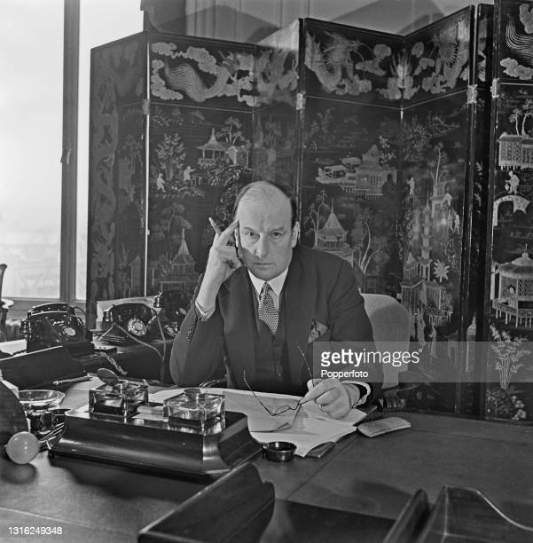 English aviator and politician John Moore-Brabazon , Minister of Transport in Winston Churchill's wartime government, seated at his desk in...