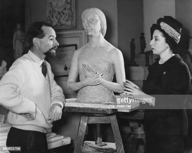 English ballerina Alicia Markova with sculptor Richard Browne and his completed bust of her, UK, 23rd February 1961.