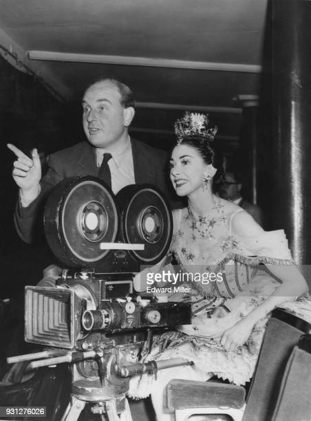 English ballerina Margot Fonteyn with director Peter Bradford during the filming of Associated British Pathé's 'Birthday Offering' at the Royal Opera...