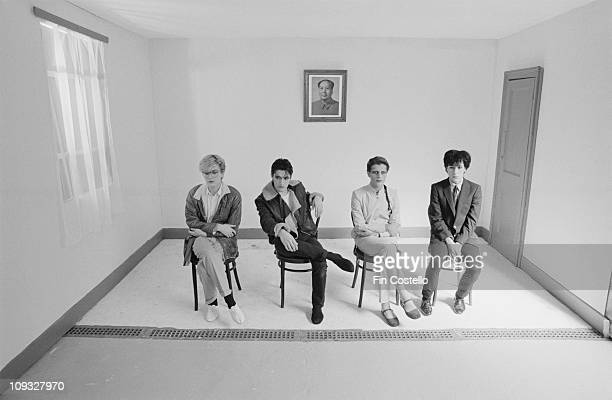 English band Japan posed sitting on chairs with a portrait of Chairman Mao behind during the Tin Drum sessions in London in September 1981 LR David...